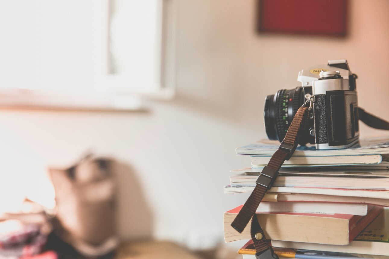 photo of a camera on top of a stack of books used for blog post social media trends 2019