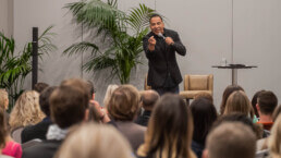 Tim Storey on stage giving his seminar to an audience