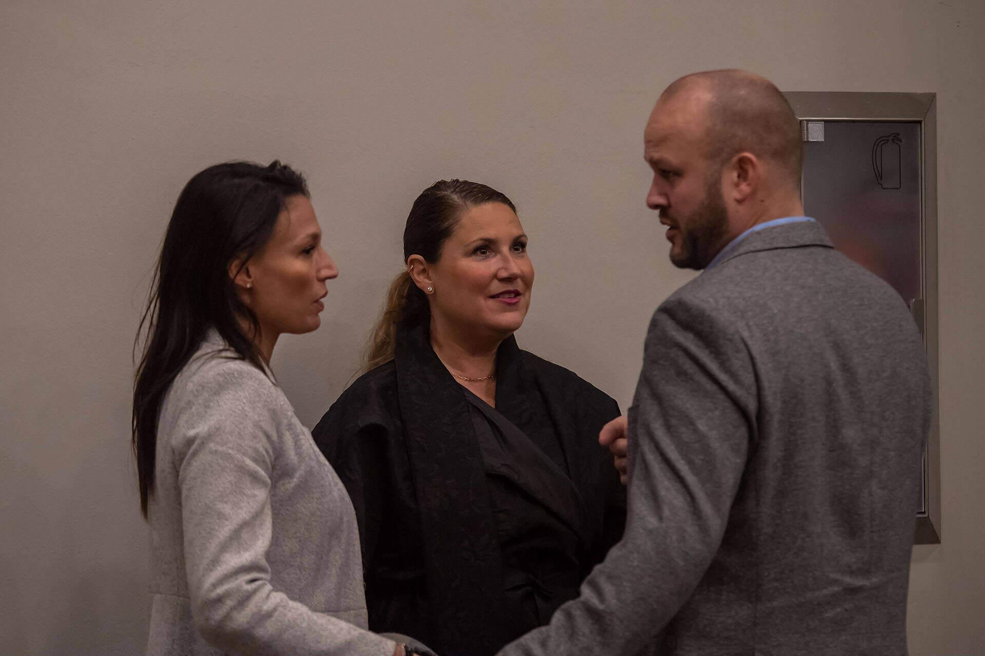 Three people talking in a circle