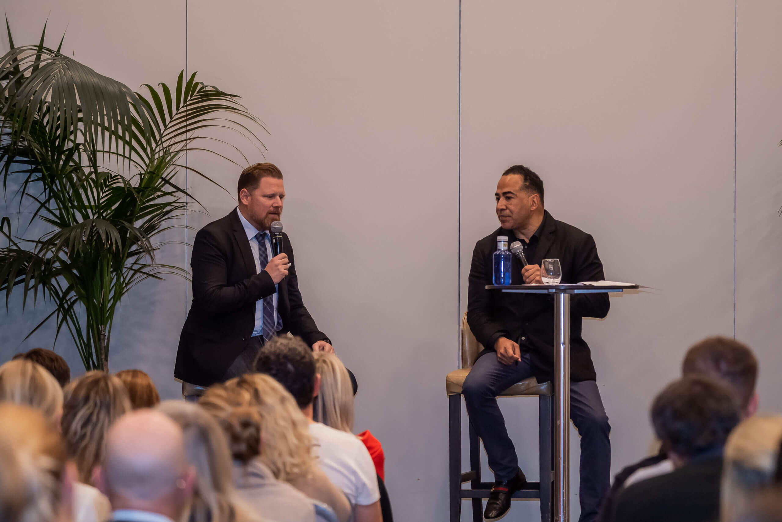 Tim Storey on stage interviewing Marcus