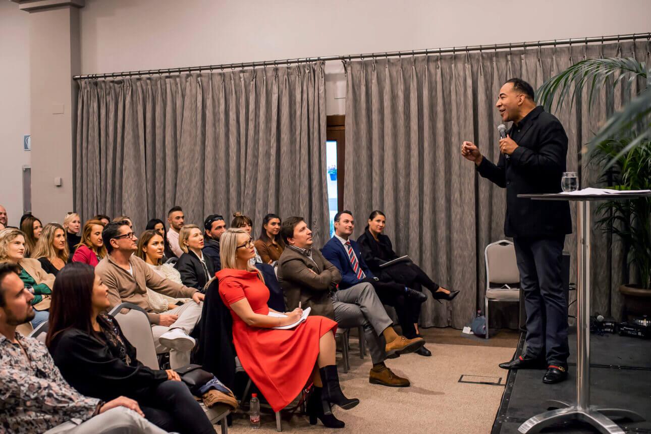 Tim Storey talking while people listen
